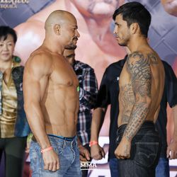 Gleison Tibau and Efrain Escudero face off at the Liddell vs. Ortiz 3 ceremonial weigh-ins in Inglewood, Calif.
