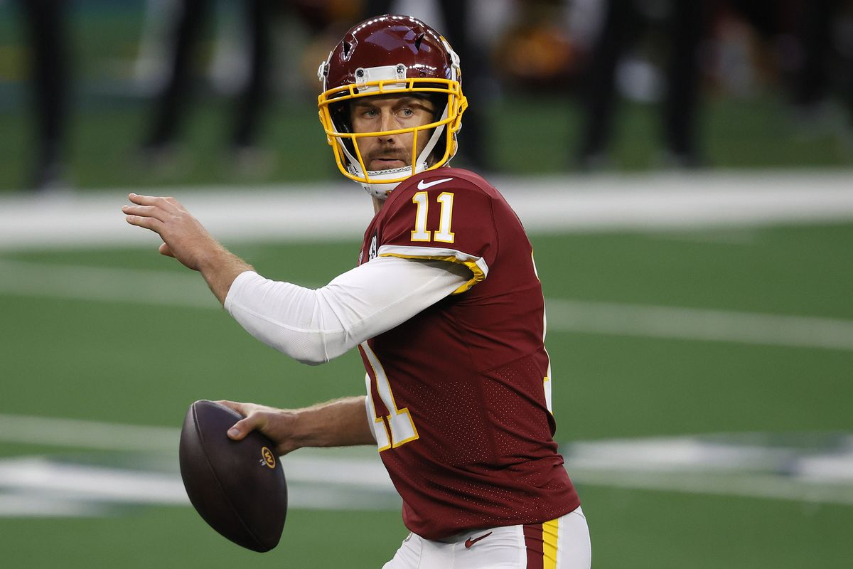 Alex Smith #11 of the Washington Football Team looks to pass during the second quarter of a game against the Dallas Cowboys at AT&T Stadium on November 26, 2020 in Arlington, Texas.