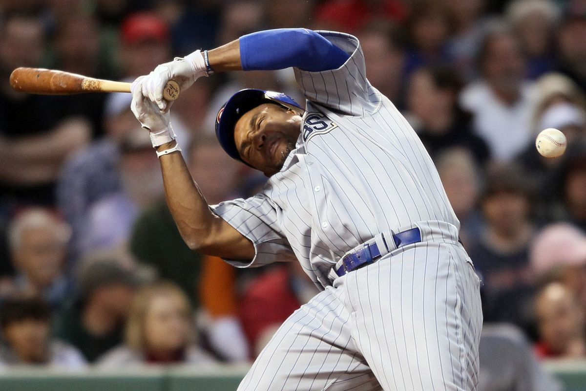 Marlon Byrd of the Chicago Cubs is hits a in the head by a pitch in the second inning against the Boston Red Sox  on May 21, 2011 at Fenway Park in Boston, Massachusetts. (Photo by Elsa/Getty Images)