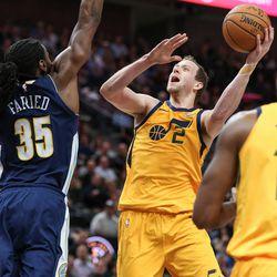 Utah Jazz forward Joe Ingles (2) goes to the hoop against Denver Nuggets forward Kenneth Faried (35) at Vivint Smart Home Arena in Salt Lake City on Tuesday, Nov. 28, 2017.