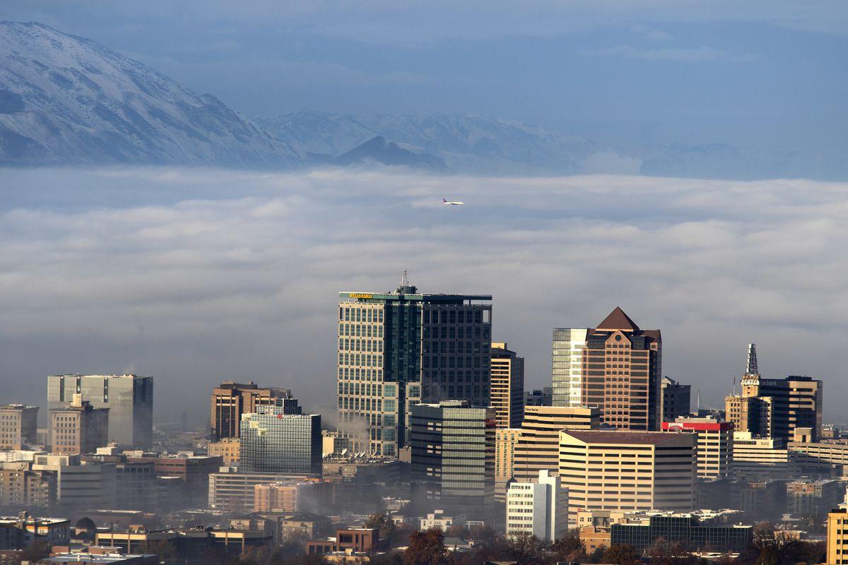 FILE - Sunrise lights the Salt Lake City skyline as a thick blanket of fog covers the Salt Lake Valley on Thursday, Nov. 29, 2018.