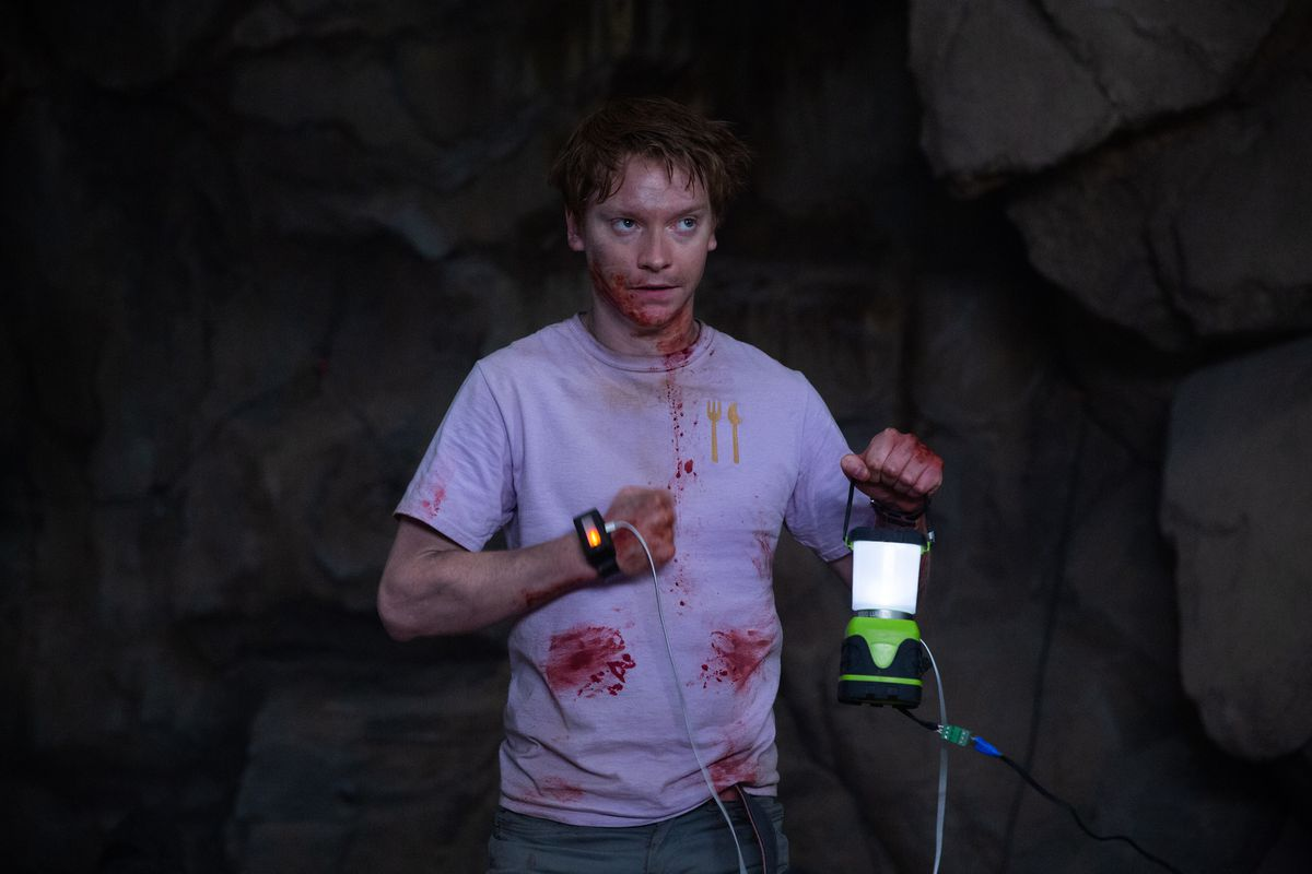 a young staffer, bloodied up, keeps a lantern aglow by jacking off with his hand in corporate animals