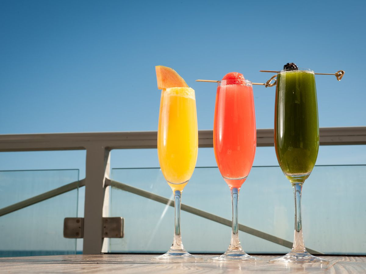 three cocktails in front of a blue sky