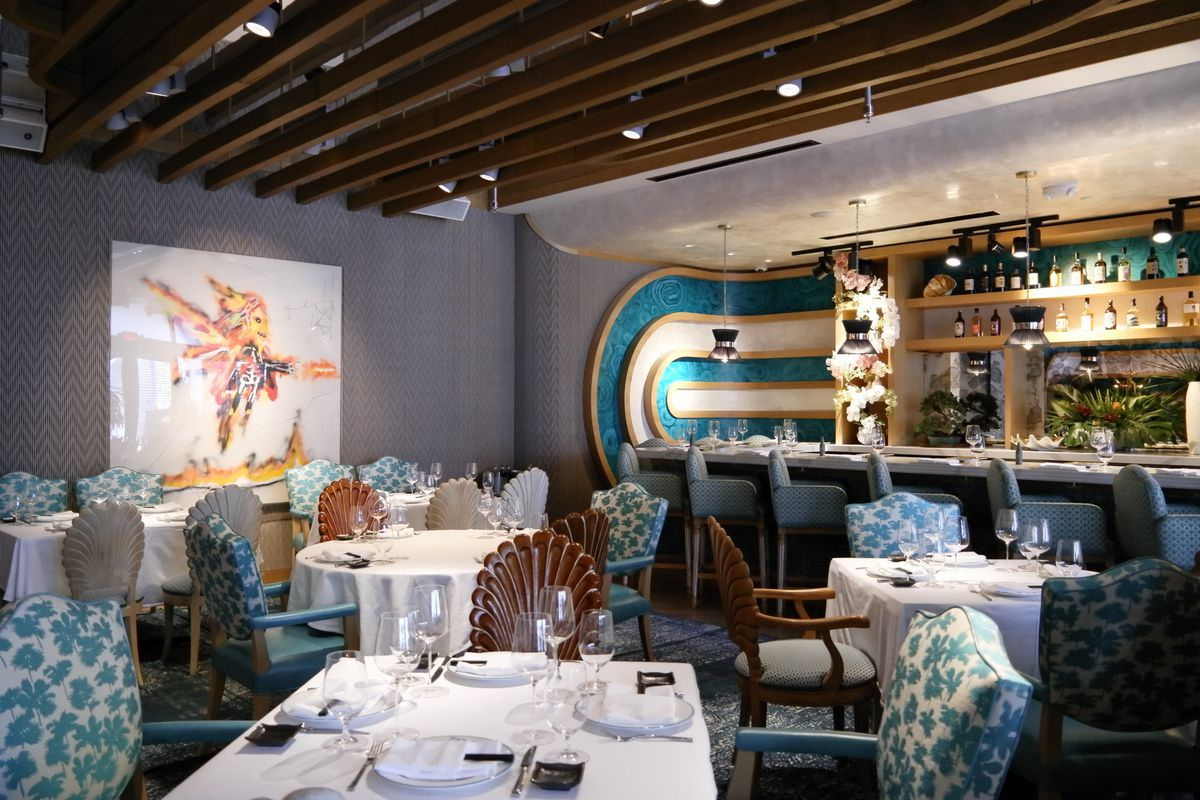The ZZ's dining room, with blue patterned chairs with clamshell backs.