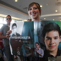 """Sixteen-year-old Kelsee Hart displays photos of her favorite """"idol"""" before the start of the American Idols Live concert at the E Center in West Valley on Monday night."""