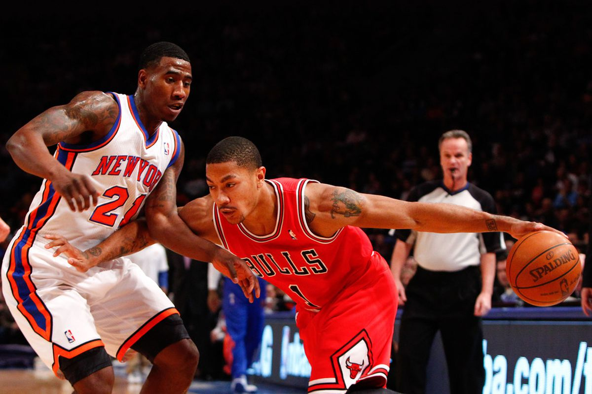 Apr. 8, 2012; New York, NY, USA; Chicago Bulls point guard Derrick Rose (1) drives the ball around New York Knicks guard Iman Shumpert (21) during the first half at Madison Square Garden. Mandatory Credit: Debby Wong-US PRESSWIRE