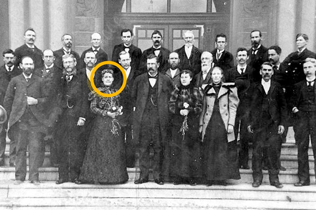 The Utah State Senate is seen in 1897. Martha Hughes Cannon, standing to the left of center, was the first woman state senator in the United States.