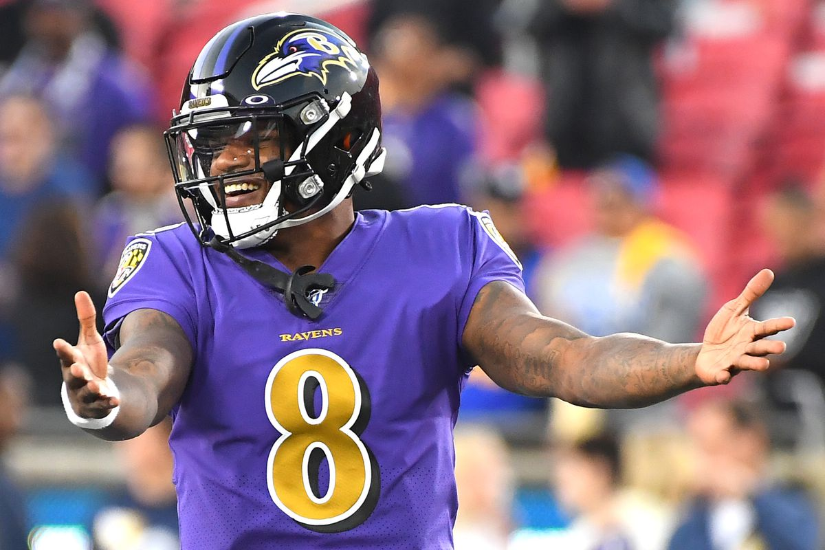 Lamar Jackson of the Baltimore Ravens warms up before the game against the Los Angeles Rams at Los Angeles Memorial Coliseum on November 25, 2019 in Los Angeles, California.