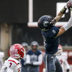Corner Canyon receiver Talmage Handley (6) surprises Peyton Wilson (7) in the first leg of the 6A football game at Rice-Eccles Stadium in Salt Lake City on Friday, Nov. 2. 22 2019.