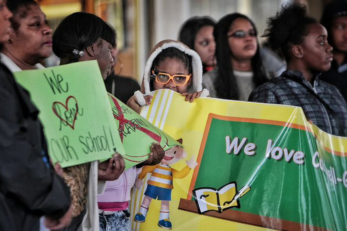 Caldwell-Guthrie Elementary School student Jonisha Simms (center) listens as parents and members of the school's neighborhood advisory council protest in December in front of the Shelby County Schools' administration building over the charter matching process established by the Achievement School District.