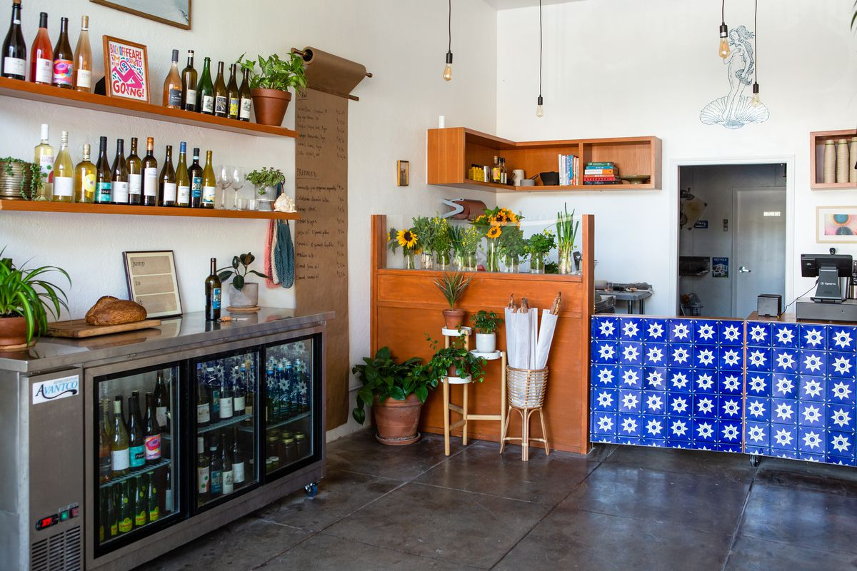 Inside a small storefront with wine and seafood and home goods items.