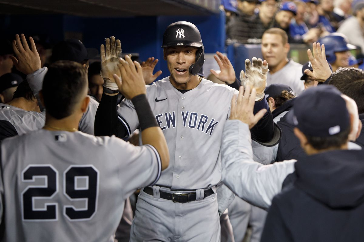 Aaron Judge #99 of the New York Yankees celebrates his solo home run in the sixth inning of their MLB game against the Toronto Blue Jays at Rogers Centre on September 30, 2021 in Toronto, Ontario.