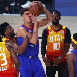 Utah Jazz' Donovan Mitchell (45), second from left, fouls Denver Nuggets' Michael Porter Jr. during the first quarter of an NBA basketball game Saturday, Aug. 8, 2020, in Lake Buena Vista, Fla.