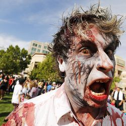 Scott Kimberlin participates in the Zombie Walk in Salt Lake City Sunday, Aug. 30, 2015. The eighth annual Zombie Walk was held to raise awareness and donations for the Utah Food Bank.