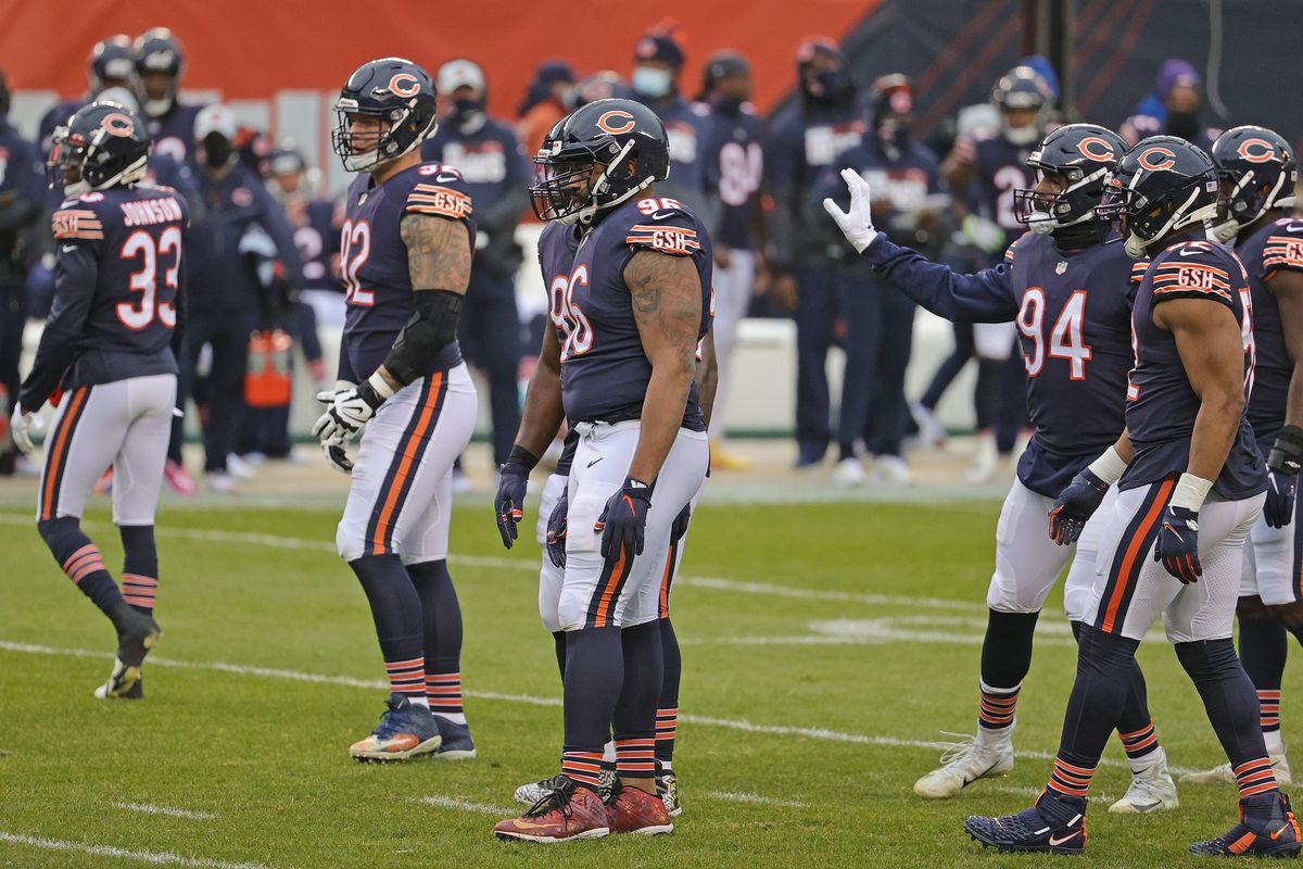 Members of the Chicago Bears defense await the start of play against the Detroit Lions at Soldier Field on December 06, 2020 in Chicago, Illinois. The Lions defeated the Bears 34-30.