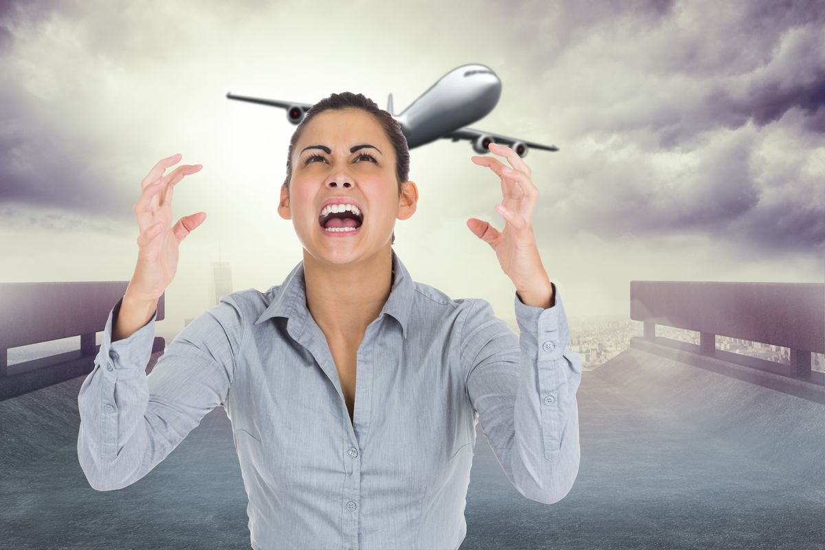 Look how angry this stock art model is about this airplane flying by!  (Shutterstock)