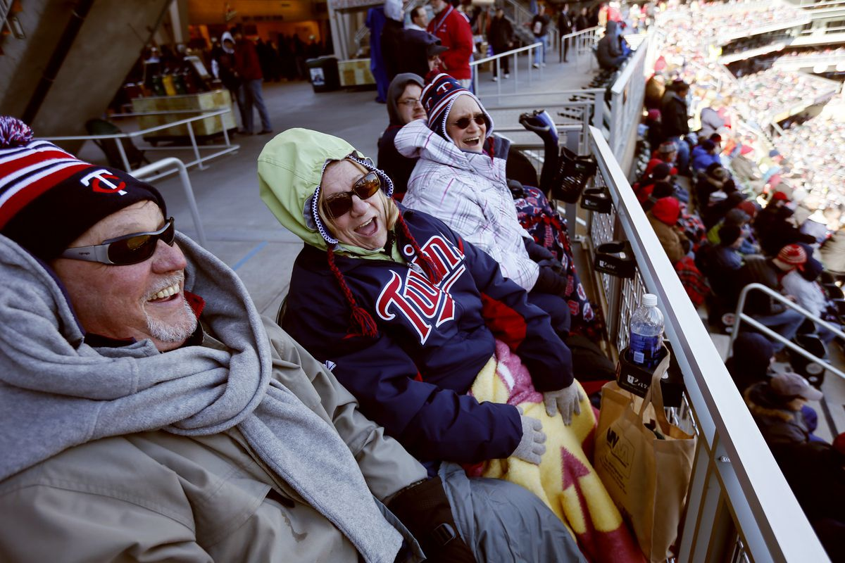 Twins fans left to right Denny Friederichs , Helene Dale, and Cindy Mines were all bundled up for the cold as the Twins took on the Detroit Tigers on opening day at Target Field , Monday April, 01, 2013 in Minneapolis, MN. ] JERRY HOLT • jerry.ho