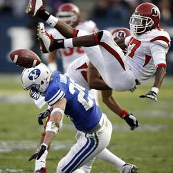 Utah defensive back Robert Johnson gets upended while going for a ball over BYU wide receiver Luke Ashworth as BYU and Utah play at LaVell Edwards Stadium Saturday in Provo. BYU won in overtime, 26-23.