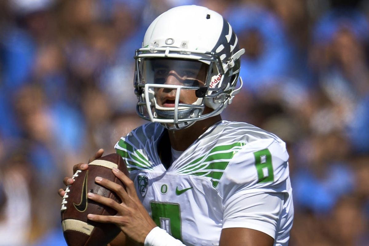 Oregon quarterback Marcus Mariota and his Ducks served notice that they're not going anywhere with a 42-30 route of the hometown Bruins of UCLA.