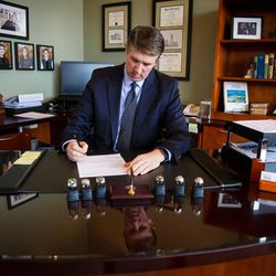 Utah Valley University  President Matthew S. Holland works in his office on the UVU campus in Orem on Wednesday March 15, 2017.