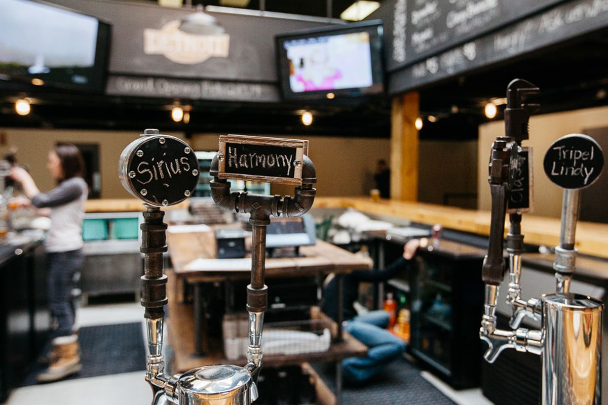 A close up of tap handles inside the Brew Detroit taproom.