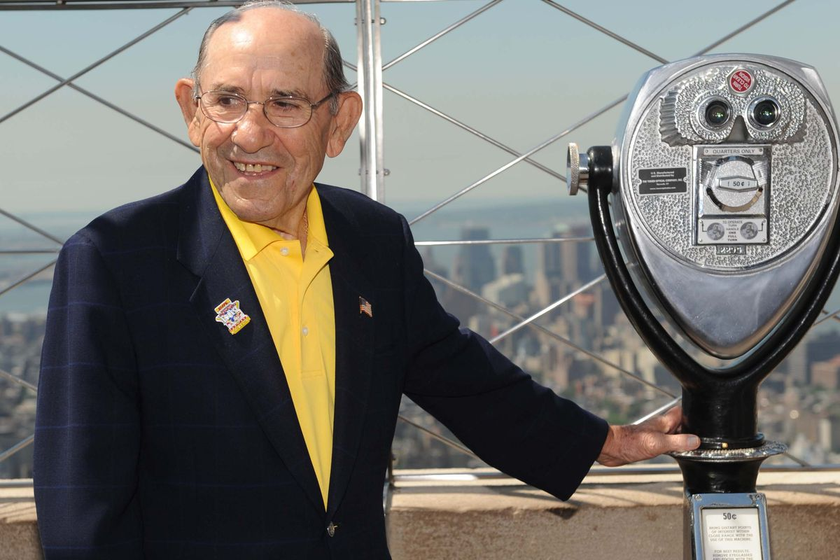 Former Major League Baseball player and manager Yogi Berra poses at a lighting ceremony at the Empire State Building in celebration of MLB All-Star Week July 11, 2008, in New York City.