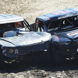 Brian Deegan in the Monster Energy 38 truck bangs with RJ Anderson in the Rockstar 37 truck as racers compete in the Pro 2 division in the Lucas Off-Road races in Tooele on Saturday, June 24, 2017.
