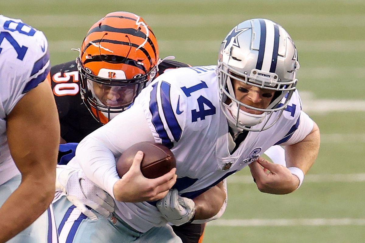Jordan Evans #50 of the Cincinnati Bengals sacks Andy Dalton #14 of the Dallas Cowboys in the fourth quarter at Paul Brown Stadium on December 13, 2020 in Cincinnati, Ohio.