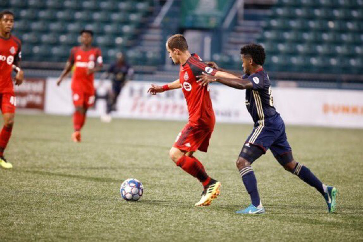USL Photo - Toronto FC II's defender Tim Kubel, holds off the pressure from an opponent against Bethlehem Steel FC at Rochester's Marina Auto Stadium on Thursday