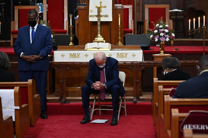 Biden sits near the altar in the sanctuary at Bethel AME.