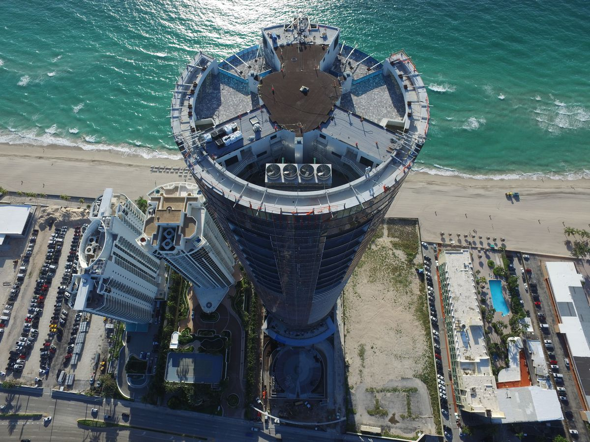 Aerial of a circular tower on the ocean in Sunny Isles
