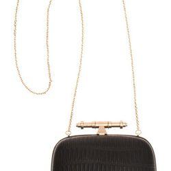 "<b>Givenchy</b> Obsedia Minaudière in black, <a href=""http://www.barneys.com/Givenchy-Obsedia-Minaudi%C3%A8re/00505011914983,default,pd.html?q=Minaudi%C3%A8re&index=10#"">$979</a> at Barneys New York"