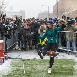 A woman attempts to kick a football 43 yards to win NFL tickets to any game outside Goose Islands Tap House, Saturday, Jan. 12, 2019, in Chicago. Goose Island sponsored the event encouraging participants to attempt a similar field goal that Chicago Bears Kicker Corey Parkey missed in a playoff game against the Philadelphia Eagles which resulted in the Bears losing the game.   Tyler LaRiviere/Sun-Times