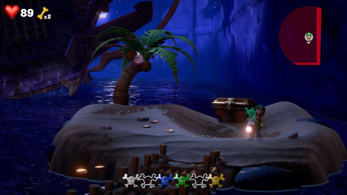 Luigi reveals a green gem in a chest in Luigi's Mansion 3