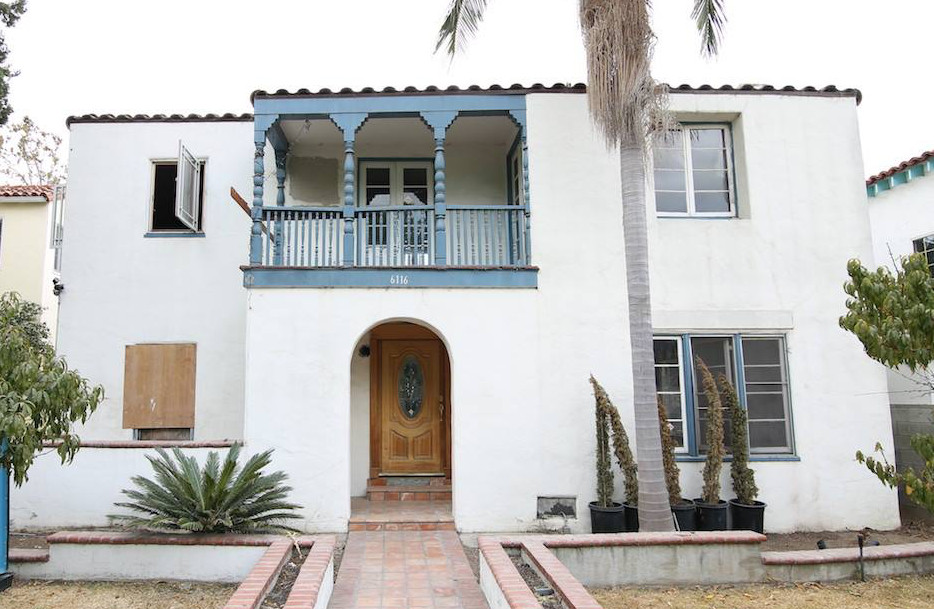 White Spanish-style home with a second-level balcony