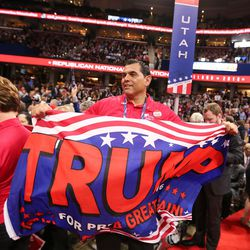 Saul Soltero waves a Donald Trump flag during the final night of the National Republican Convention in Cleveland on Thursday, July 21, 2016.