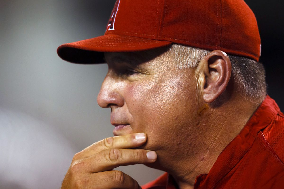 July 16, 2012; Detroit, MI, USA; Los Angeles Angels manager Mike Scioscia (14) watches from the dugout during the seventh inning against the Detroit Tigers at Comerica Park. Detroit won 8-6. Mandatory Credit: Rick Osentoski-US PRESSWIRE