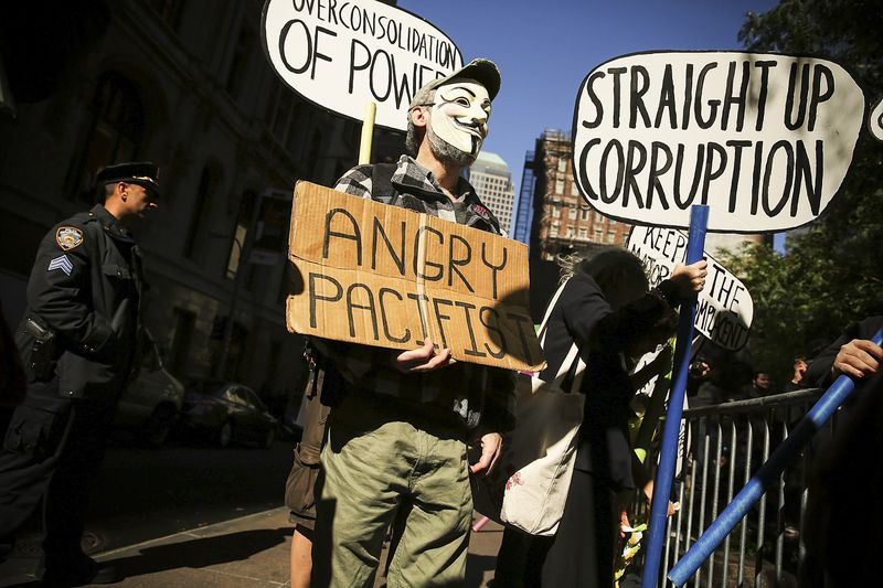 Protesters with Occupy Wall Street demonstrate for a variety of causes at Zuccotti Park near the New York Stock Exchange on the second anniversary of the movement on September 17, 2013 in New York City.