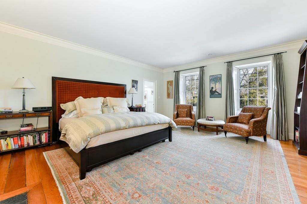 A large bedroom with a bed.