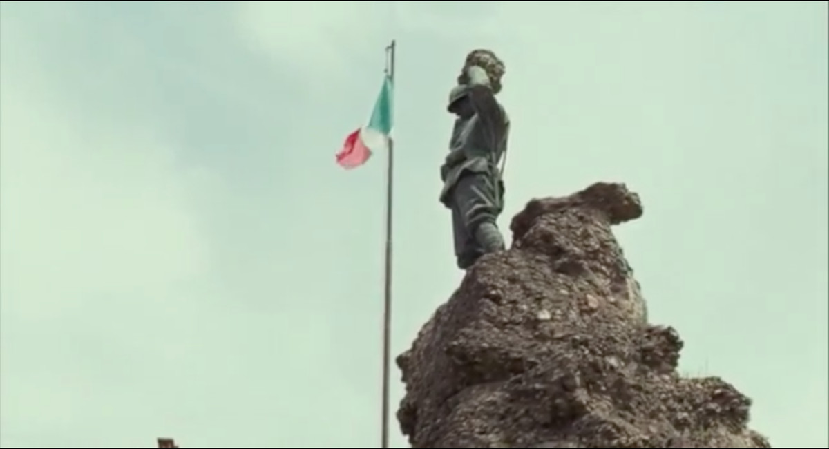 Shot of the soldier monument and an Italian flag