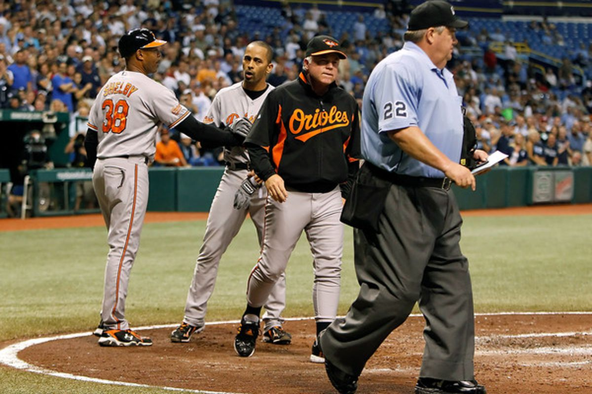 Manager Buck Showalter talks with homeplate umpire Joe West after he ejected Julio Lugo. I believe he was asking to make the ejection for four games, not just one. (Photo by J. Meric/Getty Images)