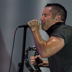 Trent Reznor of Nine Inch Nails embraced the '90s trend with a mock turtleneck.