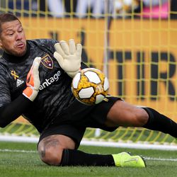 Real Salt Lake goalkeeper Nick Rimando (18) makes a stop as Real Salt Lake and the Houston Dynamo play an MLS soccer match at Rio Tinto Stadium in Sandy on Sunday, Sept. 29, 2019.