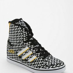 """<strong>4. Adidas Tech Hidden Wedge High-Top Sneaker, On sale for <a href=""""http://www.urbanoutfitters.com/urban/catalog/productdetail.jsp"""">$84</a>  </strong> These Adidas graphic high-top sneakers will instantly elevate a simple t shirt and pair of jean"""