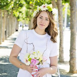 """The bride wears a dress and shoes from Zara and Benefit Cosmetics makeup. Her flower crown, bouquet, and ring were made by her friend and jewelry designer <a href=""""http://instagram.com/jess_hannah#"""">Jessica Revesz</a>."""