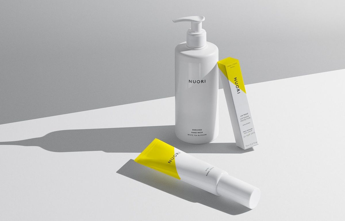 Three skincare products in white and yellow packaging on a white background