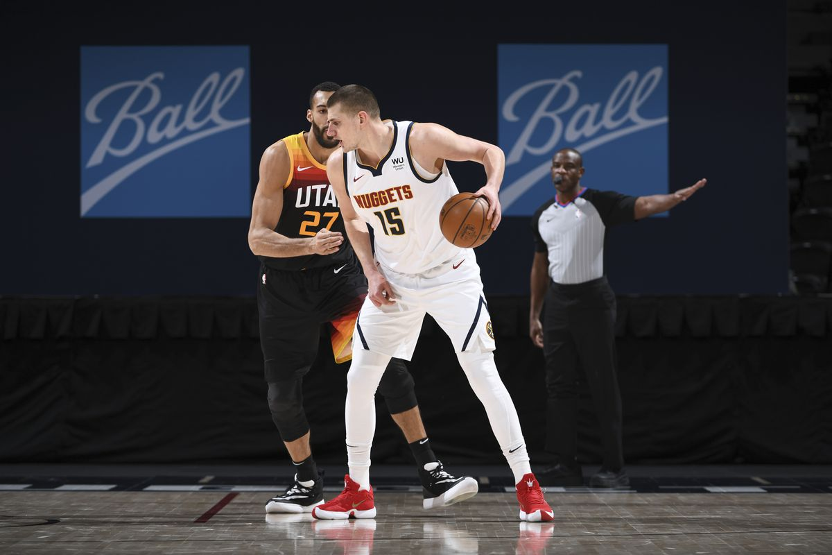 Nikola Jokic of the Denver Nuggets dribbles during the game against the Utah Jazz on January 31, 2021 at the Ball Arena in Denver, Colorado.