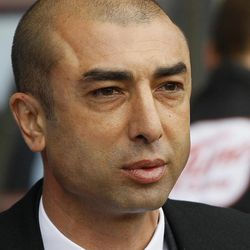 Chelsea's caretaker manager Roberto Di Matteo watches his players ahead of the English Premier League soccer match between Chelsea and Aston Villa at Villa Park Stadium in Birmingham, Saturday, March 31, 2012.