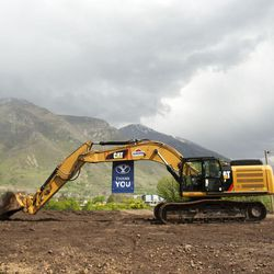 A banner thanking donors is displayed from the arm of an excavator during the groundbreaking ceremony for a new engineering building at BYU in Provo on Monday, May 9, 2016. The new building was entirely funded by donors.