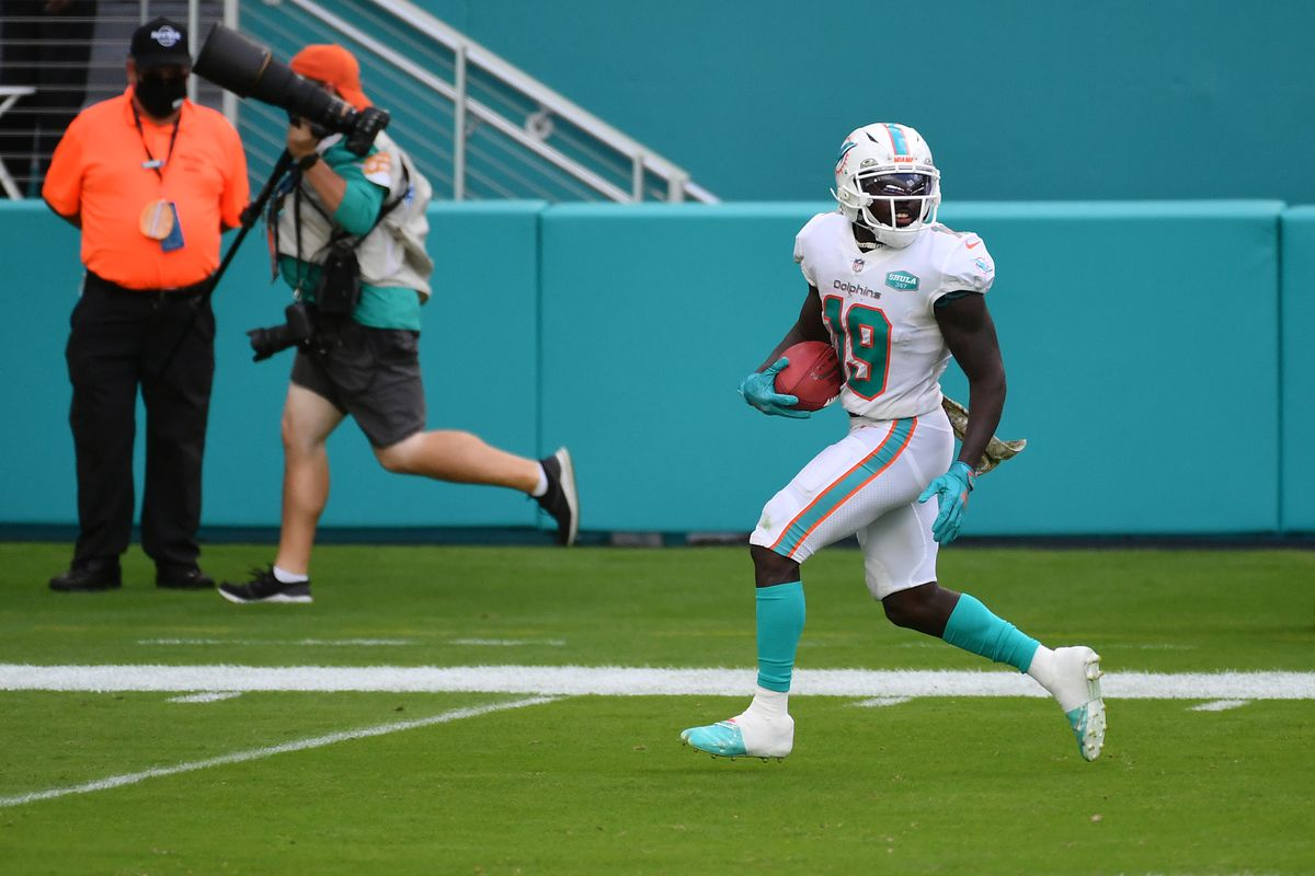 Miami Dolphins wide receiver Jakeem Grant (19) runs a punt return for a touchdown against the Los Angeles Rams during the first half at Hard Rock Stadium.